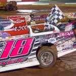 Michael Page of Douglasville, GA had the dominant car on Saturday night at Talladega Short Track in Eastaboga, AL as he celebrates his first career NeSmith Chevrolet Dirt Late Model Series win. Page lead wire-to-wire in the caution-free 50-lap race driving the #18x M&M Truck and Trailer Repair Special. (NeSmith Media Photo by Bruce Carroll)